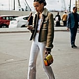 With a White Crop Top, Suede Aviator Jacket, and Colorful Sneakers