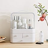 The Wonline Modern Cosmetic Organizer Storage Holder, ($50) features a dust-proof caddy shelf on top for taller products and three drawers.