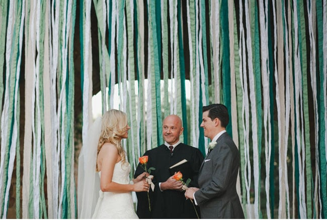 Lots and lots of hanging streamers feel fun and festive, adding a bit of whimsy to your big moment. Photo by The Nichols via Green Wedding Shoes