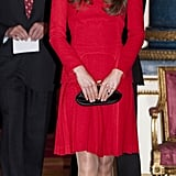 She Sprung For a Red Pleated Alexander McQueen While at Buckingham Palace; It Was Her Second Time Donning the Bold Number