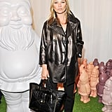 Kate Moss wore a Mulberry look for its London Fashion Week show in September 2012. The ensemble comprised a peacoat, silk blouse, ankle-length trousers, and the highly coveted Willow tote.