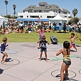 Have a hula hoop competition.