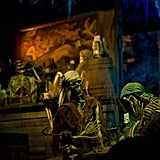 Real human skeletons were used as props when Pirates of the Caribbean first opened.