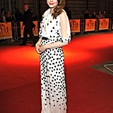 . . . And again at the UK premiere of The Help. She dazzled in this Luca Luca dress with shoulder cutouts.