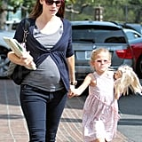 Jennifer Garner carried a gift to a birthday party.