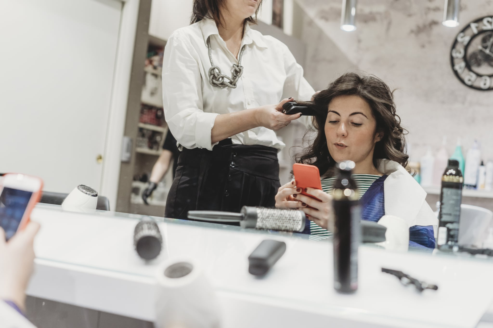 Young adult woman at the hairdresser