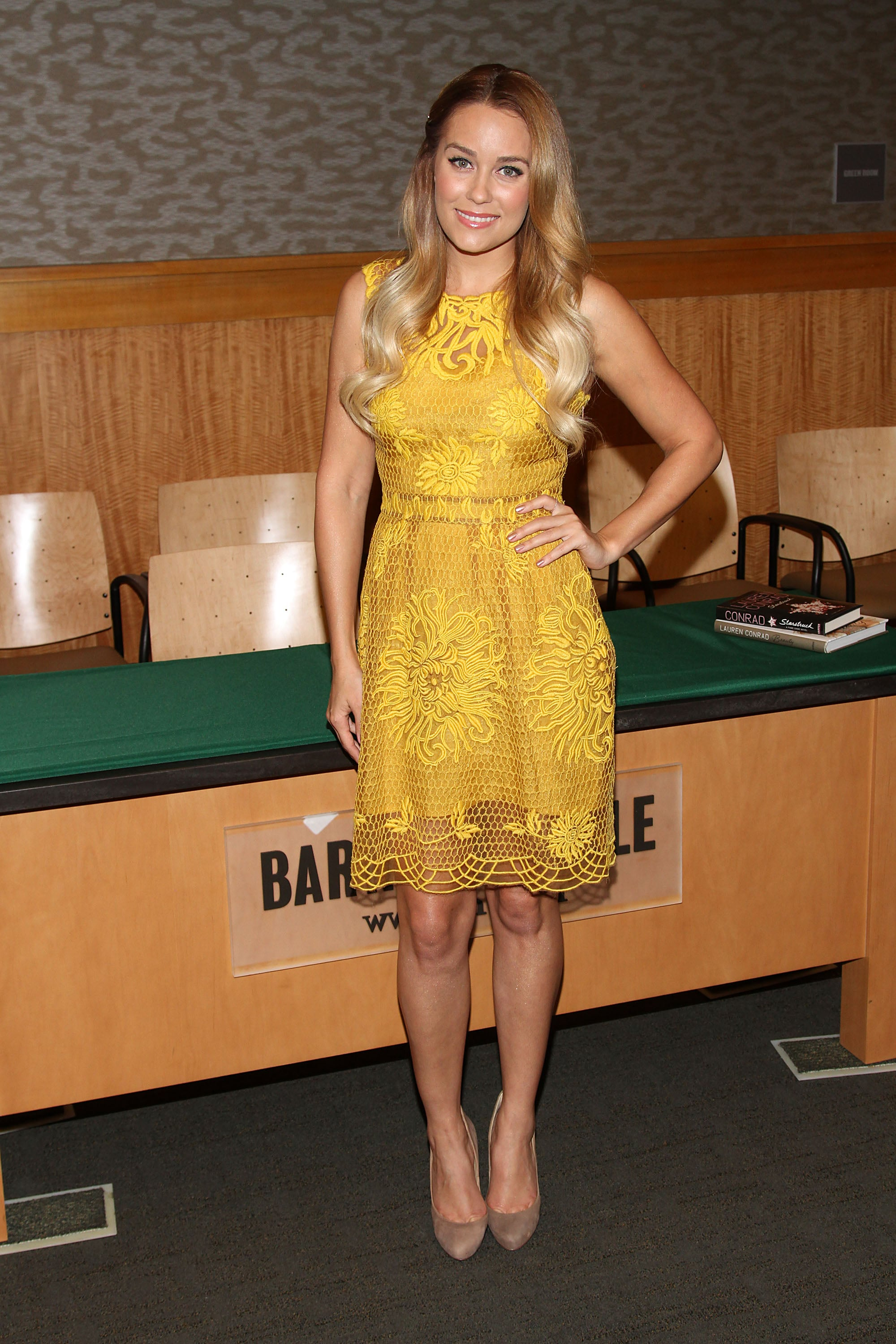 Lauren wore a bright yellow Yoana Baraschi party dress for a book signing at Barnes & Noble in 2012. Lesson from Lauren: no need to over-accessorize a gorgeous dress.
