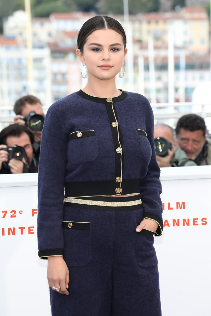 "The Cannes Film Festival officially kicked off on Tuesday, and all eyes were likely on Selena Gomez as she made her first-ever appearance. Clad in a sexy all-white ensemble, the 26-year-old singer was on hand to promote her new star-studded film, The Dead Don't Die. Selena was joined by her costars, including Adam Driver, Bill Murray, Tilda Swinton, Luka Sabbat, and Chloë Sevigny. Following the event, Selena switched up her look for a white strapless dress and attended the festival's gala dinner. The next day, she rocked a cropped navy top with matching pants as she attended a photocall and press conference for the film. She also posted a series of selfies on Instagram, writing, ""hi Cannes...you're very pretty.""  The Dead Don't Die was directed by Jim Jarmusch and hits theaters on June 14. It centers around a town called Centerville that suddenly finds itself overrun with zombies. Given that the festival is 11 days long, hopefully this means we'll be seeing more of Selena in the days to come.       Related:                                                                                                           Selena Gomez's Airport Outfit Reminds Us of Rachel Green — and Not Just Because of Her Hair"