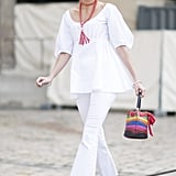 Brighten an all white outfit with rainbow accessories.