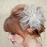 We love the soft tulle pleats on this LoBoheme bridal fascinator ($128).