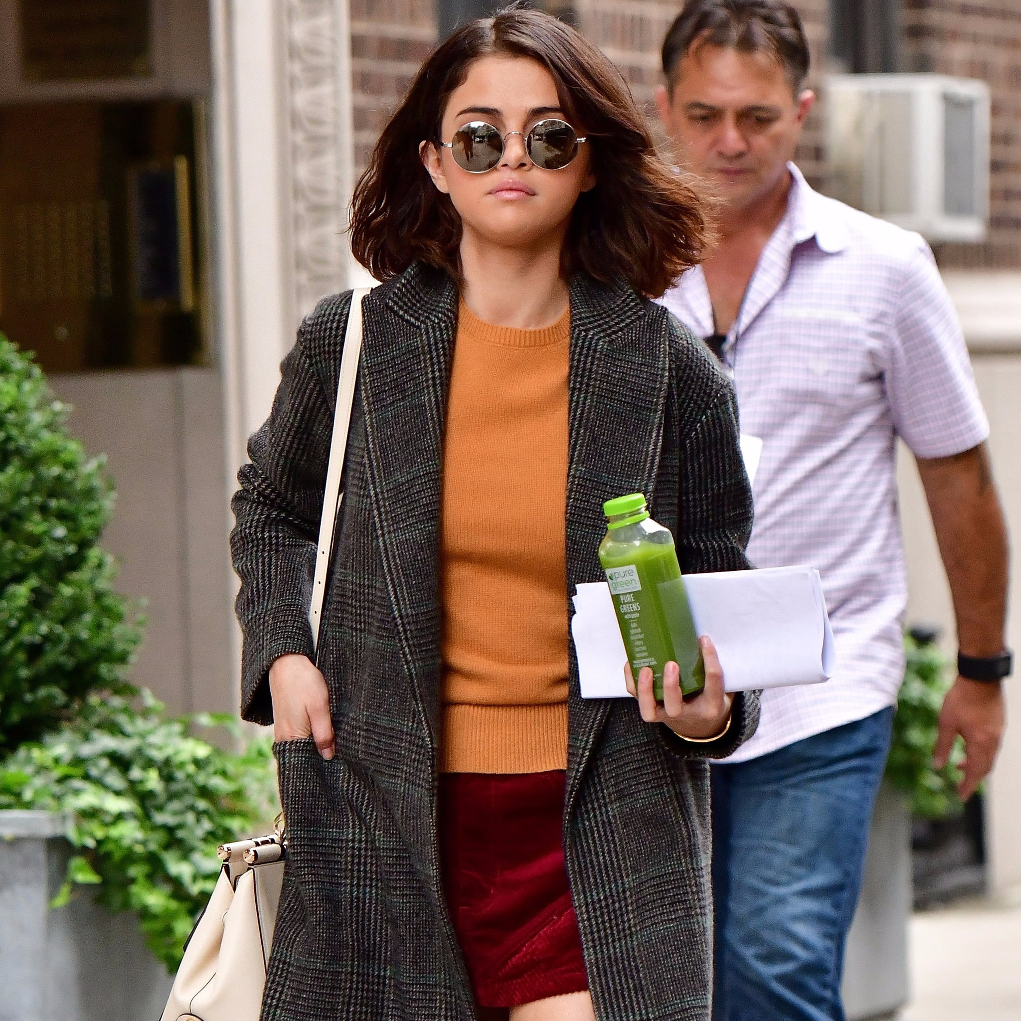 353d37b001 Selena Gomez s Orange Sweater and Red Skirt