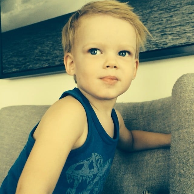 Luca Comrie perfected his modeling pose for his dad, Mike Comrie. Source: Instagram user hilaryduff