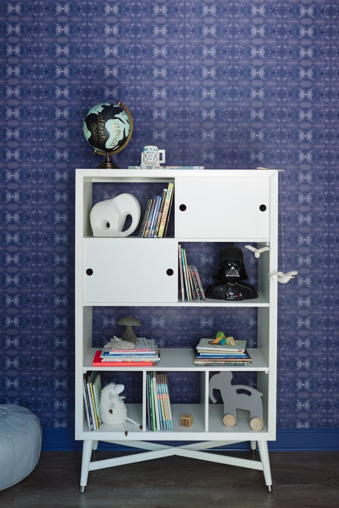 The Darth Vader phone has pride of place on the Mid-Century French White Bookcase ($899). The patterned wallpaper is from Eskayel.