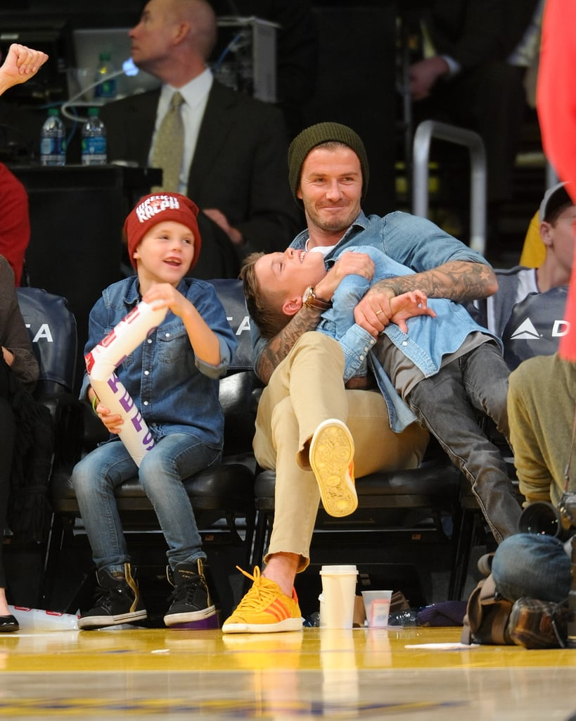 David Beckham was joined by all three sons, Brooklyn Beckham, Cruz Beckham, and Romeo Beckham, at LA's Staples Center to take in a Lakers game.