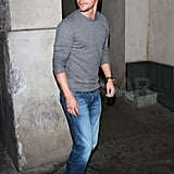 Derek Hough dressed casual in jeans and sneakers.