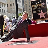 Bryan Cranston struck a funny pose over his new star on the Hollywood Walk of Fame.
