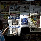 A man in Colombia checked out the newspapers covering Nelson Mandela's passing.