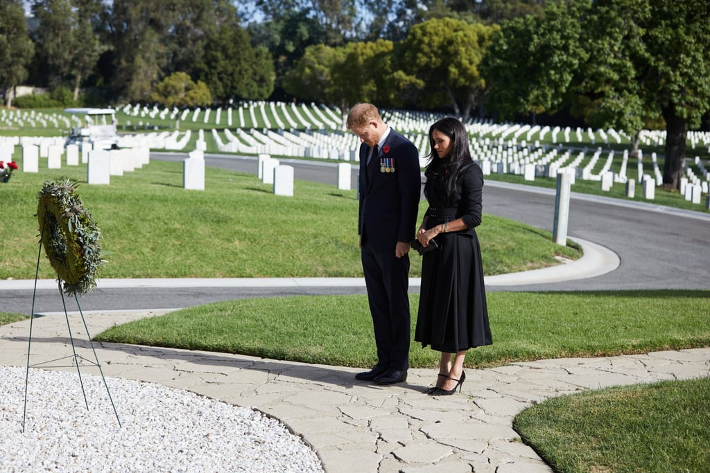 """Meghan Markle and Prince Harry recognized Remembrance Sunday in their own way on Nov. 8. Hours after the rest of the royal family participated in the traditional Sunday service across the pond, the Duke and Duchess of Sussex made a private visit to the Los Angeles National Cemetery to pay tribute to those who have served and those who have fallen.  The couple — who wore masks around other visitors — laid flowers that Meghan picked from their garden at the graves of two Commonwealth soldiers, one from the Royal Australian Air Force and one from the Royal Canadian Artillery. They also left a wreath, as is traditionally done on the holiday, inscribed with a plaque that reads, """"In Memory of the Men Who Offered Their Lives in Defence of Their Country."""" Harry also attached a personal note to the wreath. """"To all of those who have served, and are serving,"""" he wrote. """"Thank you.""""  Although Harry did not attend the services with his family in the United Kingdom, he did make a surprise appearance on the Declassified podcast for a special Remembrance Day episode. As a former member of the British Armed Forces, Harry explained that he feels an important bond with other veterans. """"Being able to wear my uniform, being able to stand up in service of one's country, these are amongst the greatest honors there are in life,"""" he said. """"To me, the uniform is a symbol of something much bigger, it's symbolic of our commitment to protecting our country, as well as protecting our values. These values are put in action through service, and service is what happens in the quiet and in the chaos."""" See more from Harry and Meghan's Remembrance Sunday tribute ahead."""