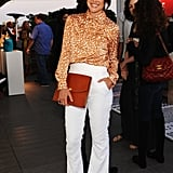 90210's Jessica Stroup was the picture of retro cool-girl style in a silky printed blouse and flared white trousers.