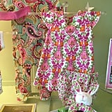 Three-piece Layette Set, including footie, hat, and rattle ($60) Dress and Bloomers Set in Lily Bell ($49)