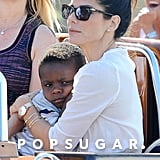 Sandra Bullock held on to her son, Louis, as they rode a water taxi in Venice, Italy.