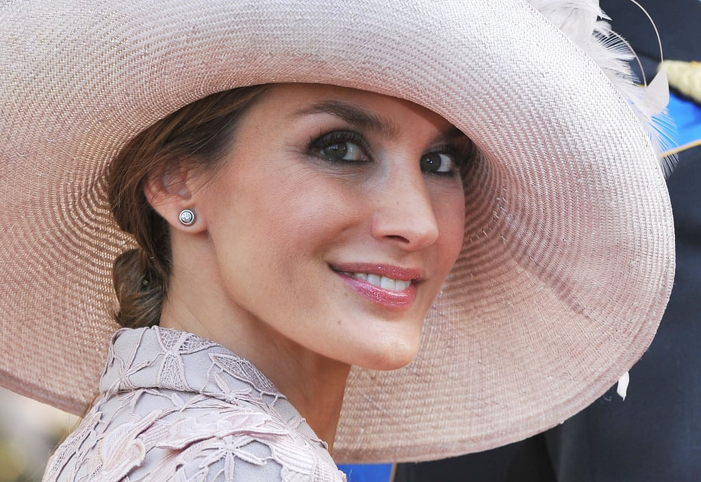The Duchess of Cambridge may get a lot of attention in the international royal world, but Queen Letizia of Spain has been quietly giving her a run for her money in the glamour department. The Spanish royal, who was named the queen consort when her husband, King Felipe VI, took the crown in June, has managed to mix easy casualness with regal elegance in everything she does, be it receiving guests at the Zarzuela Palace in Madrid or taking family vacations to Palma de Mallorca. Letizia and Felipe are also not shy when it comes to showing PDA, proving that they are truly modern royals. Keep reading for Letizia's best moments from over the years.