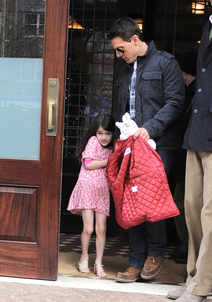 Tom and Suri Cruise left their Manhattan hotel today to run some afternoon errands. Suri seemed reluctant to cover up her colorful dress, but Tom brought along her red Dolce & Gabbana jacket just in case. The 6-year-old spent the last few days exploring the Big Apple with Katie, including a stop at FAO Schwarz, before Tom returned home yesterday. He racked up an impressive amount of frequent flier miles over the past few weeks traveling around the world promoting his latest blockbuster, Mission: Impossible — Ghost Protocol. Tom made it back to the East Coast in time for Monday's stateside premiere of the film and, more importantly, Katie's 33rd birthday! Katie turns 33 on Sunday, but we'll have to wait and see if, like last year, she celebrates by seeing a Broadway production.