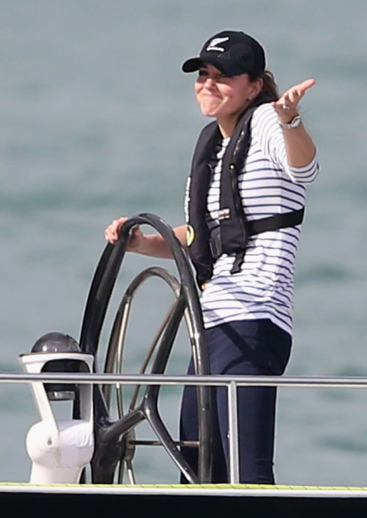 "The face says it all! Kate shrugged and smiled as she passed William's boat during a friendly race in Auckland, New Zealand, on April 11. William later said he was ""sabotaged."""