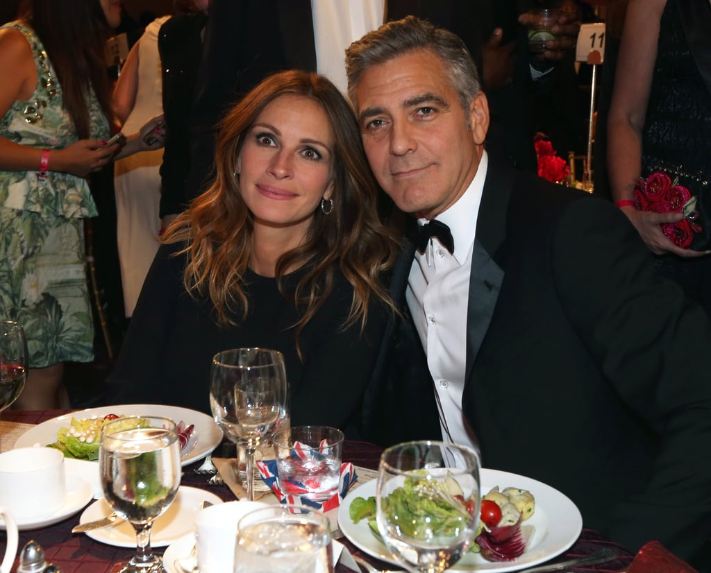 Julia Roberts and George Clooney posed together at their table.