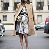 Sweet daytime style in the form of a pretty printed dress and chic camel coat to top it off. Source: Le 21ème | Adam Katz Sinding