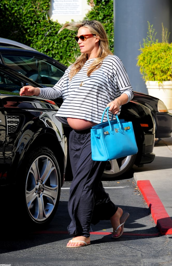 Pregnant Molly Sims wore a striped tee.
