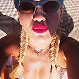 Bright lips and fishtail braids were Rita Ora's look while lounging poolside. Source: Instagram user ritaora