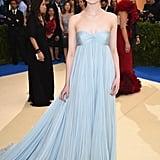 Elle Fanning in a Blue Gown as . . .