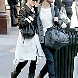 Anne Hathaway and Adam Shulman each toted bags during their walk.