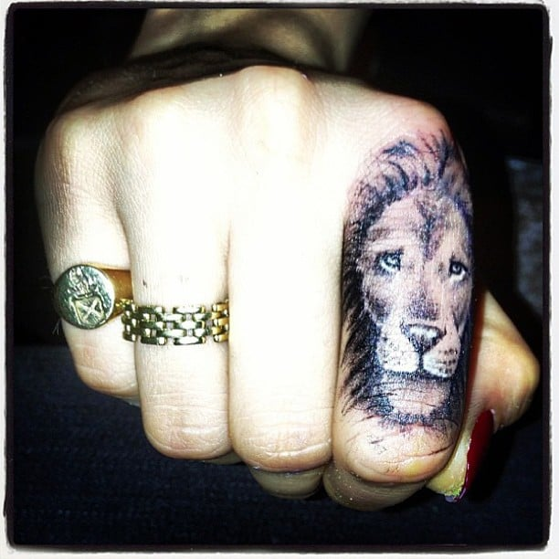 Cara Delevingne revealed her first tattoo on Instagram, a lion on her finger. Source: Instagram user caradelevingne