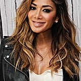 Dishevelled waves with plenty of golden highlights, a sideswept parting, and seriously smoky eyes worked perfectly with Nicole's leather jacket at an AOL event in July 2015.