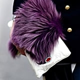 A purple fur stole and white clutch provided textural intrigue to this look.