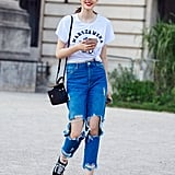 With Distressed Jeans and a Graphic Tee