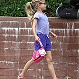 Violet Affleck carried a pink purse.