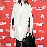 Mary Elizabeth Winstead took a more feminine approach to her ensemble, pairing a white car coat with a chic black tote.