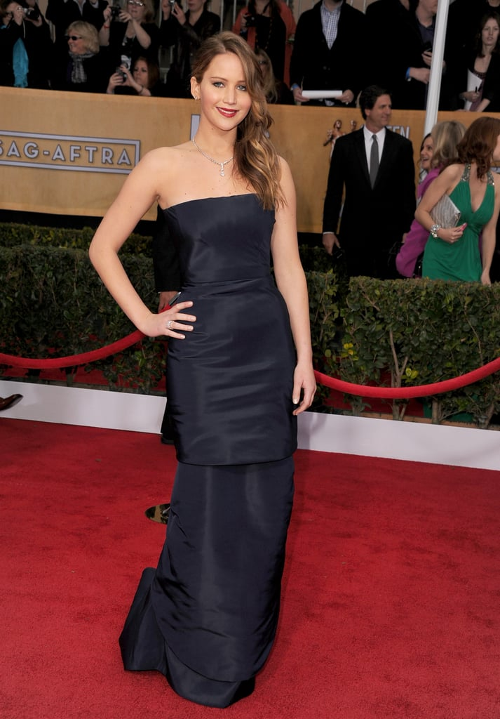 Jennifer Lawrence also chose a strapless Christian Dior Haute Couture gown, though hers was navy blue.