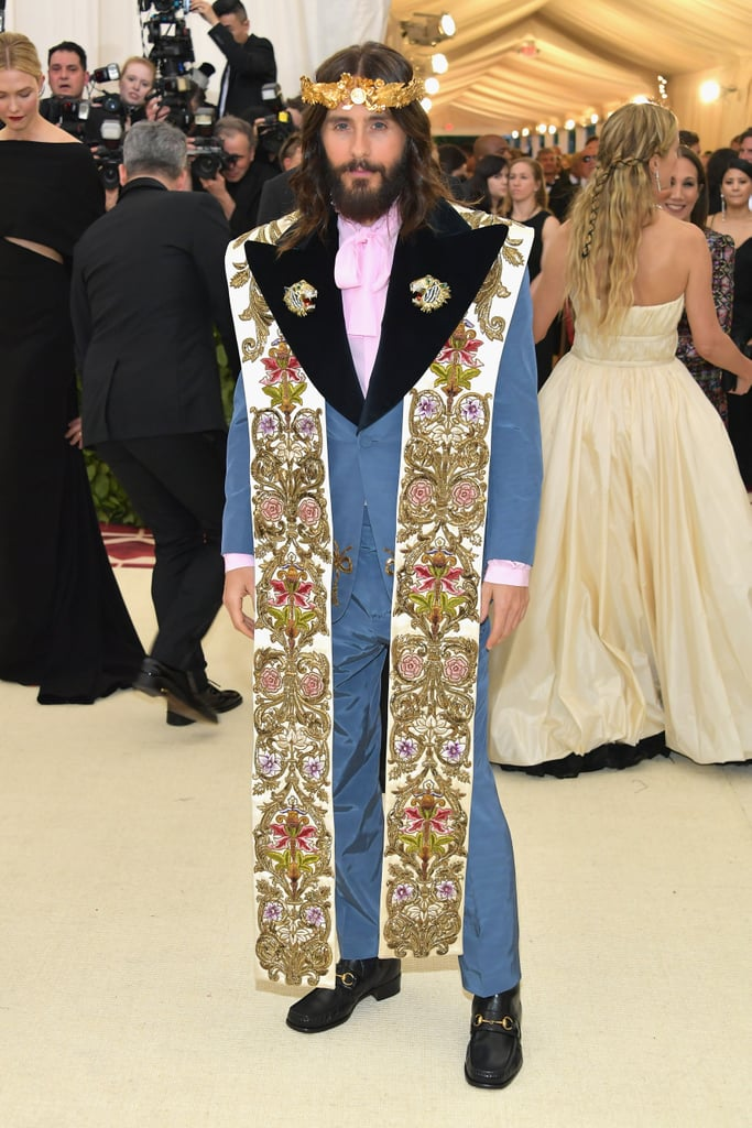 "When this year's Met Gala theme was announced as ""Heavenly Bodies: Fashion and the Catholic Imagination,"" Jared Leto probably didn't bat an eye; even though the Oscar winner and Thirty Seconds to Mars singer has drawn comparisons to Jesus quite a bit over the years — that long hair and bushy beard really do the trick — Monday night's event was a really fun way for him to shine. Jared hit the red carpet in a blue suit, which he topped with an intricate clergy stole and, of course, a gold crown. The 46-year-old had to know how biblical he looked. He flashed a thumbs-up while posing for photos with Lana Del Rey and Gucci designer Alessandro Michele, who crafted their looks.      Related:                                                                                                           Proof That Jared Leto Has Had as Many Girlfriends as He Has Hairstyles"