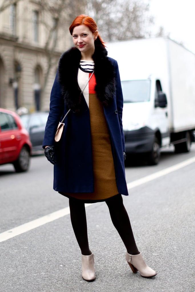 Our fashion news editor Christina Perez showed off minimalist dressing with a cozy fur collar.