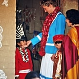 Diana greeted a child at the Tamana Special Needs Nursery School in Delhi, India, in February 1992.