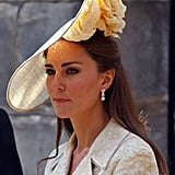 At Zara Phillips's wedding, Kate Middleton wore a cream white hat that came complete with a rose detail.