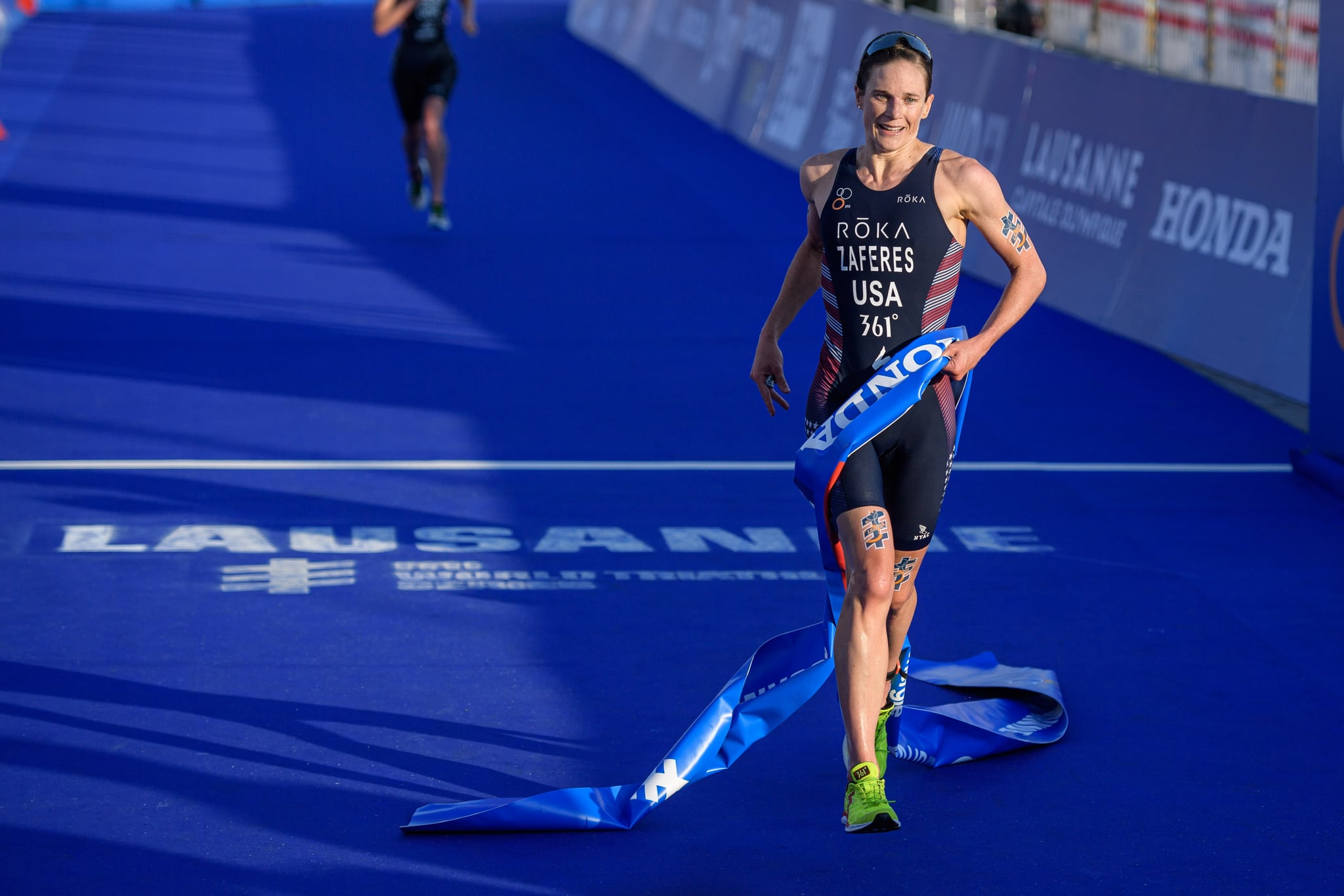 LAUSANNE, SWITZERLAND - AUGUST 31: Katie Zaferes of the United States reacts after her win during the women's elite olympic race at the ITU World Triathlon Grand Final on August 31, 2019 in Lausanne, Switzerland. (Photo by Jörg Schüler/Getty Images)