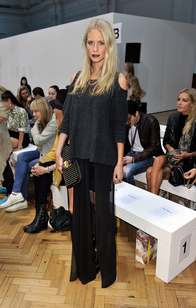 Poppy Delevingne channeled a moody look in a sheer, split maxi, charcoal knit, and a dark burgundy lip at Sass & Bide.