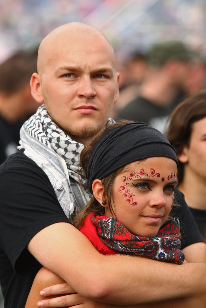 Fans embraced during a performance at the International Woodstock Festival in Kostrzyn, Poland.