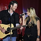 """May 2010: Blake proposed to Miranda on May 9, 2010, after asking her father for his blessing. """"I fumbled it up a little,"""" Blake told Us Weekly about his proposal. """"It's funny how you rehearse those things and go over what you want to say, but I probably screwed it up."""" Miranda described the excitement of being engaged to Blake to People at the time, saying, """"Weddings are great and engagements are great, and diamonds are especially great, but I'm just excited to be married because I want to tell Blake I really can love him the rest of my life and be happy and make him happy.""""  May 2011: A year after getting engaged, the country cuties tied the knot in Boerne, TX. According to Us Weekly, Ashley Monroe sang """"Makin' Plans"""" as Miranda walked down the aisle, and Blake later performed """"Let's Grow Old Together"""" for his bride.  July 2011: After saying """"I do"""" earlier that Spring, the """"Honey Bee"""" singer released his sixth studio album, Red River Blue, in July. The album featured his new wife on the title track and gave Blake four No. 1 singles.  November 2011: Miranda followed in her husband's footsteps in 2011 by releasing her own album, Four the Record, in the Fall. The song """"Over You"""" was another cowrite credited to Miranda and Blake and led to two major award wins for Miranda.  2011: Blake became a coach on The Voice, which brought his life to Los Angeles in addition to spending time touring and being back home in Oklahoma with Miranda. Throughout his time on the NBC series, Miranda made time to appear as his team's mentor and give performances on the show."""