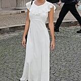 Emily Ratajkowski Arrived at the Miu Miu Show Wearing a White Prada Dress